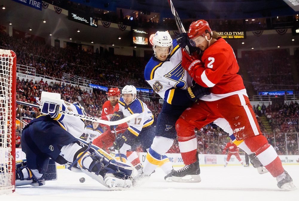 Mar 22, 2015; Detroit, MI, USA; St. Louis Blues goalie Jake Allen (34) makes a save as defenseman Petteri Lindbohm (48) and Detroit Red Wings defenseman Brendan Smith (2) fight for position with in the first period at Joe Louis Arena. Mandatory Credit: Rick Osentoski-USA TODAY Sports