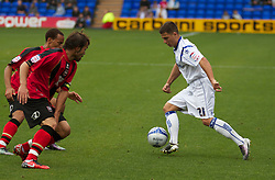 BIRKENHEAD, ENGLAND - Saturday, October 2, 2010: Tranmere Rovers' Dale Jennings in action against Brighton & Hove Albion's captain Inigo Calderon and Elliott Bennett during the Football League One match at Prenton Park. (Photo by Vegard Grott/Propaganda)