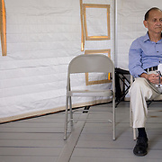 OCTOBER 24 - PONCE, PUERTO RICO - <br /> Veterans  Elvin Pagan, 78, waits for his ride after a check up in a temporary hospital tent set up outside the Ponce VA hospital.<br /> (Photo by Angel Valentin/Freelance)