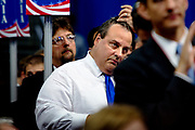 New Jersey Governor Chris Christie listens to speakers as he waits to hear the acceptance speech by Presidential Hopeful Mitt Romney at the GOP National Convention held at the Tampa Bay Forum.