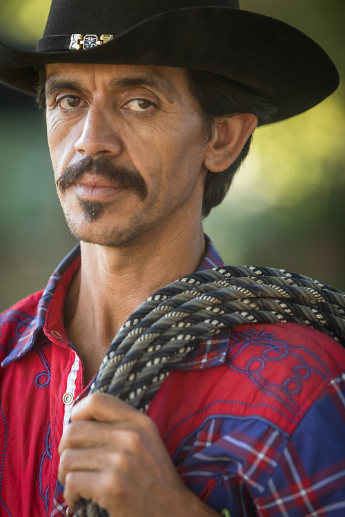 Sonoma County resident, house painter, and weekend bull wrangler, Manuel Anduiano, assists at Charreria (Mexican Rodeo) over the Fourth of July weekend in Calistoga.