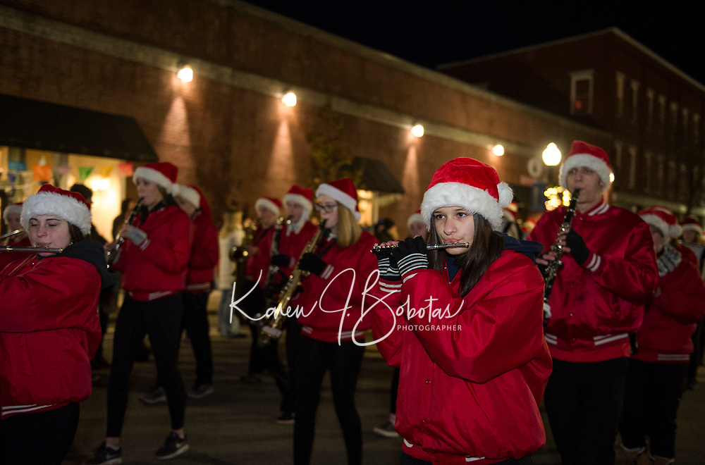 """The Belmont Marching Band marching down Main Street during the """"Light Up Laconia"""" Holiday Parade Sunday evening.  (Karen Bobotas/for the Laconia Daily Sun)"""