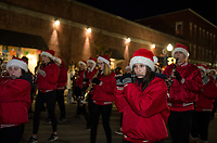 "The Belmont Marching Band marching down Main Street during the ""Light Up Laconia"" Holiday Parade Sunday evening.  (Karen Bobotas/for the Laconia Daily Sun)"