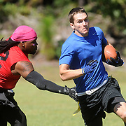 Defense in Depth's Seth Streget rushes against YGH at Castle Hayne Park Sunday October 5, 2014. (Jason A. Frizzelle(