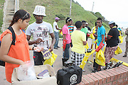 Nawaal Domingo of the Southern Durban Community Environmental Alliance (SCDEA)/KZN, with youth from Johannesburg, Durban and Limpopo before the beach cleanup exercise, 1 December 2011