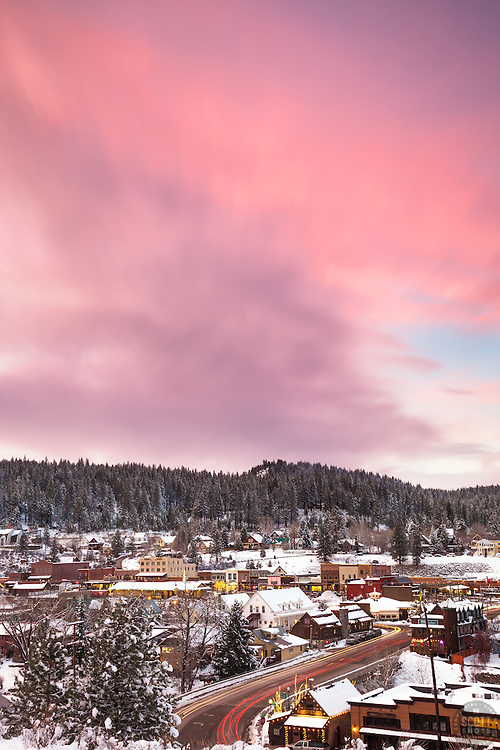 """Downtown Truckee Sunset 2"" - Photograph of a snowy Downtown Truckee with a pink sunset above it."