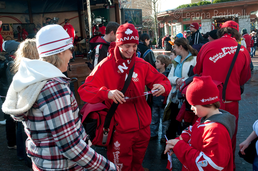 Fans for the Canadian Olympic team wear red, wear flags and maple leaf tatoos during the 2010 Olympic Winter Games in Whistler, BC Canada.