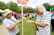 Tea Party member Ted Tripp of North Andover, Mass., left, and Obama supporter Dan Mann of Andover, Masss., right, discuss politics at a Tea Party Express rally in Manchester, N.H., Monday, Sept. 5, 2011. (Cheryl Senter for the New York Times)