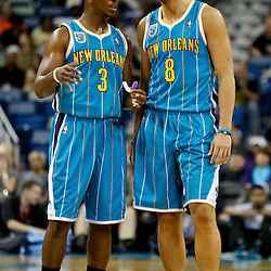 October 9, 2010; New Orleans, LA, USA; New Orleans Hornets point guard Chris Paul (3) talks with shooting guard Marco Belinelli (8) during the first quarter of a preseason game against the Memphis Grizzlies at the New Orleans Arena. Mandatory Credit: Derick E. Hingle