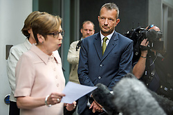 © Licensed to London News Pictures. 18/07/2018. London, UK. FRAN UNSWORTH (left), Head of BBC News, stands next to JONATHAN MUNRO (right), Head of Newsgathering, as she reads a statement to media outside the Rolls Building of the High Court in London where judges ruled in favour of a claim by Sir Cliff Richard for damages against the BBC for loss of earnings. The 77-year-old singer sued the corporation after his home in Sunningdale, Berkshire was raided following allegations of sexual assault made to Metropolitan Police. Photo credit: Ben Cawthra/LNP