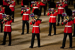 © Licensed to London News Pictures. LONDON, UK  09/06/11. The massed bands of the Guards Brigade march in formation during the annual Beating of the Retreat at Horse Guards Parade. On two successive evenings each year in June a pageant of military music, precision drill and colour takes place on Horse Guards Parade in the heart of London when the Massed Bands of the Household Division carry out the Ceremony of Beating Retreat. 300 musicians, drummers and pipers perform this age-old ceremony. The Retreat has origins in the early days of chivalry when beating or sounding retreat pulled a halt to the days fighting. Please see special instructions. Photo credit should read Matt Cetti Roberts/LNP. Please see special instructions for usage rates. Photo credit should read Matt Cetti-Roberts/LNP