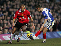 Photo: Lee Earle.<br /> Portsmouth v Manchester United. The Barclays Premiership. 11/02/2006. United's Wes Brown (L) takes on Matthew Taylor.