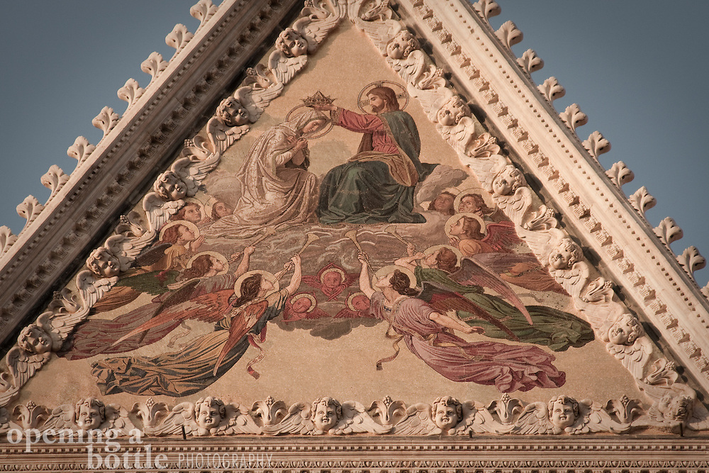 Detail of the fresco crowning the facade of the Siena Duomo, Sienna, Tuscany, Italy. Full color image available upon request.