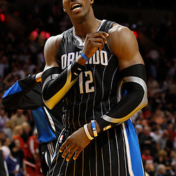 March 3, 2011; Miami, FL, USA; Orlando Magic center Dwight Howard (12) reacts after a win over the Miami Heat at the American Airlines Arena. The Magic defeated the Heat 99-96.    Mandatory Credit: Derick E. Hingle