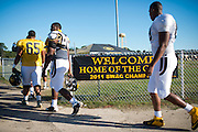Grambling State University football players walk to practice in Grambling, Louisiana on October 23, 2013. The football team, known as the G-Men, were the 2011 SWAC Champions and have not defeated an NCAA opponent since.  (Cooper Neill for The New York Times)