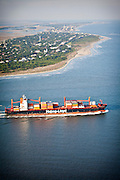 Aerial view a cargo container ship leaving Charleston, SC