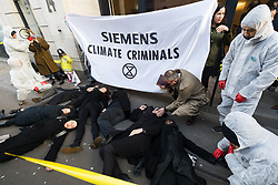 © Licensed to London News Pictures. 16/01/2020. London, UK. Extinction Rebellion activists stage a die in protest outside Siemens London offices, calling for them to pull out of a contract with the new Adani coalmine project in Australia. Environmental activists oppose the mining project and are concerned that the continued use of coal will lead to higher emissions of carbon dioxide, a gas which is linked to global warming.Photo credit: Vickie Flores/LNP