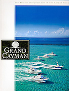 Grand Cayman Magazine cover aerial photo of charter boat fleet by photographer Courtney Platt