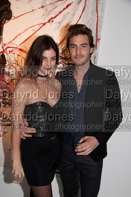JULIA RESTOIN ROITFELD; ROBERT KONJIC, Private view of the exhibition ' Mother of Pouacrus' by Nicholas Pol. Presented by Vladimir Restoin Roitfeld. The Old Dairy, Wakefield St.  London. 14 October 2010. <br /> <br /> -DO NOT ARCHIVE-© Copyright Photograph by Dafydd Jones. 248 Clapham Rd. London SW9 0PZ. Tel 0207 820 0771. www.dafjones.com.