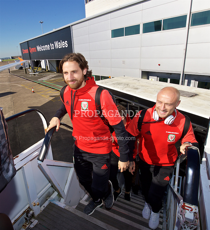 CARDIFF, WALES - Wednesday, October 5, 2016: Wales' Joe Allen and David Cotterill board the team plane at Cardiff Airport as the team travel to Vienna ahead of the 2018 FIFA World Cup Qualifying Group D match against Austria. (Pic by David Rawcliffe/Propaganda)