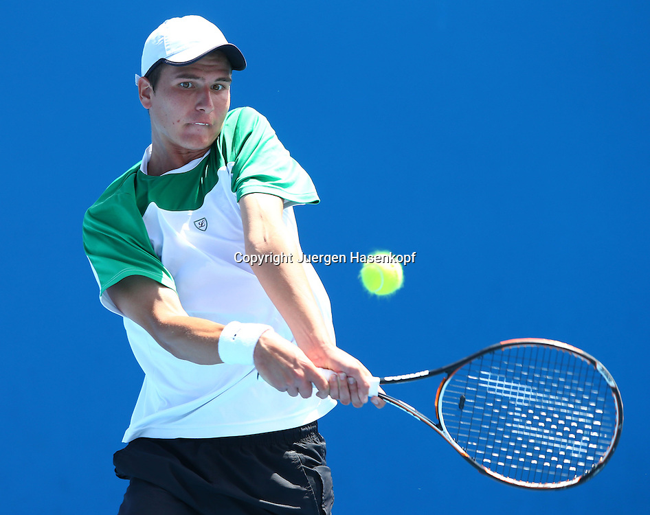 Australian Open 2013, Melbourne Park,ITF Grand Slam Tennis Tournament ,Junioren Wettbewerb,.Dominic Weidinger (AUT), Aktion,Einzelbild,Halbkoerper,Querformat