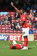 Marc-Antoine Fortune signals that Romain Vincelot  has head injury during the Sky Bet League 1 match between Scunthorpe United and Coventry City at Glanford Park, Scunthorpe, England on 12 September 2015. Photo by Ian Lyall.
