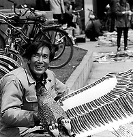A Chinese man selling kites on the banks of the Yangzte River in Wuhan.