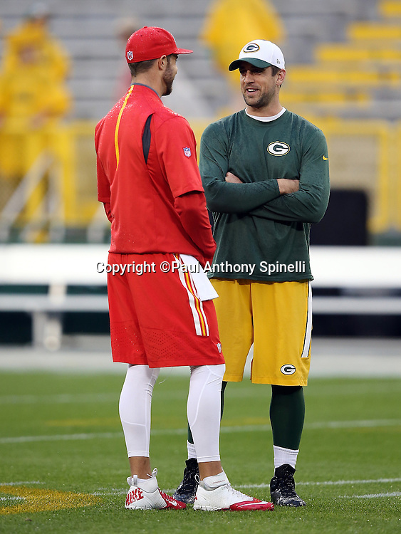Kansas City Chiefs quarterback Alex Smith (11) has a friendly chat with Green Bay Packers quarterback Aaron Rodgers (12) before the 2015 NFL week 3 regular season football game against the Green Bay Packers on Monday, Sept. 28, 2015 in Green Bay, Wis. The Packers won the game 38-28. (©Paul Anthony Spinelli)