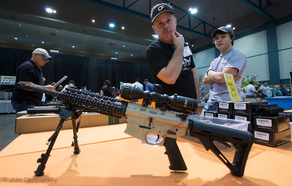 December 16th,  Danny Carter, with a custom built  AR 15 semi automatic riffle at a <br /> gun show at the Pontchartrain Center in Kenner Louisiana held by Great Southern Gun and Knife Shows L.L. C. . Gun sales have increased since the school shooting massacre in Sandy Hook Connecticut, especially AR 15s, one of the types of guns  Adam Lanza used on his killing spree, as gun owners fear new legislature will soon regulate sales of such guns.