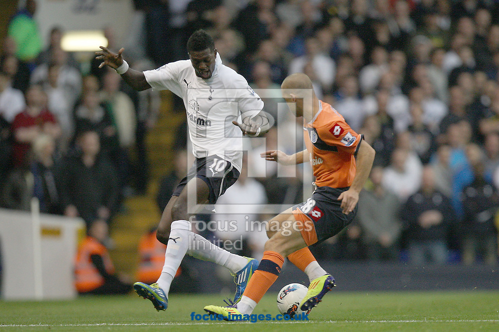 Picture by Mark Chapman/Focus Images Ltd. 0782 4770491.30/10/11.Emmanuel Adebayor (L) of Tottenham and Luke Young of QPR during the Barclays Premier League match at White Hart Lane stadium, London.