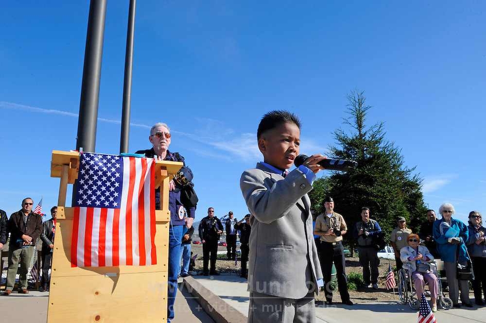 Seven year-old Xavian Balaoro from Salinas sings God Bless America at a memorial ceremony Sunday at the Monterey County Vietnam Veterans Memorial in Salinas.