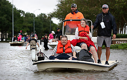 August 29, 2017 - Houston, Texas, U.S. - Rescued individuals from the Kelliwood subdivision in Houston are brought in by boat by volunteer rescue workers on Tuesday. (Credit Image: © San Antonio Express-News via ZUMA Wire)