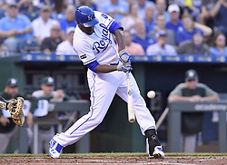 April 13, 2017 - Kansas City, MO, USA - The Kansas City Royals' Lorenzo Cain connects on an RBI single in the first inning against the Oakland Athletics at Kauffman Stadium in Kansas City, Mo., on Thursday, April 13, 2017. (Credit Image: © John Sleezer/TNS via ZUMA Wire)