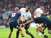 Fijian lock Leone Nakarawa try to break a tackle during the Autumn International Series match between England and Fiji at Twickenham, Richmond, United Kingdom on 19 November 2016. Photo by Ian  Muir.
