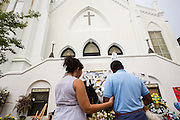 Residents continue to bring flowers and pay their respects at a makeshift memorial outside the historic Mother Emanuel African Methodist Episcopal Church June 22, 2015 in Charleston, South Carolina. Nine people killed at the church by white supremacist, Dylann Storm Roof last Wednesday.