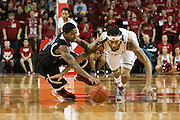 November 30, 2013: Terran Petteway (5) of the Nebraska Cornhuskers and Travon Baker (5) of the Northern Illinois Huskies go for a loose ball at the Pinnacle Bank Areana, Lincoln, NE. Nebraska defeated Northern Illinois 63 to 58.