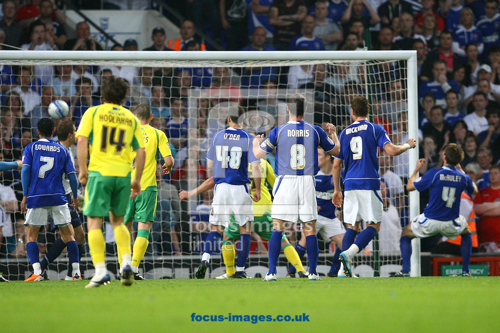 Ipswich - Thursday April 21st, 2011: Norwich's 2nd goal is an own goal scored by Ipswich's Gareth McAuley (no 4) during the Npower Championship match at Portman Road, Ipswich. (Pic by Paul Chesterton/Focus Images)