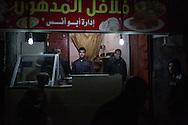 A felafel shop in the Al Shate' illuminated by the generators, northern Gaza City. Un negozio di felafel  illuminato dai generatori nel nord di Gaza City