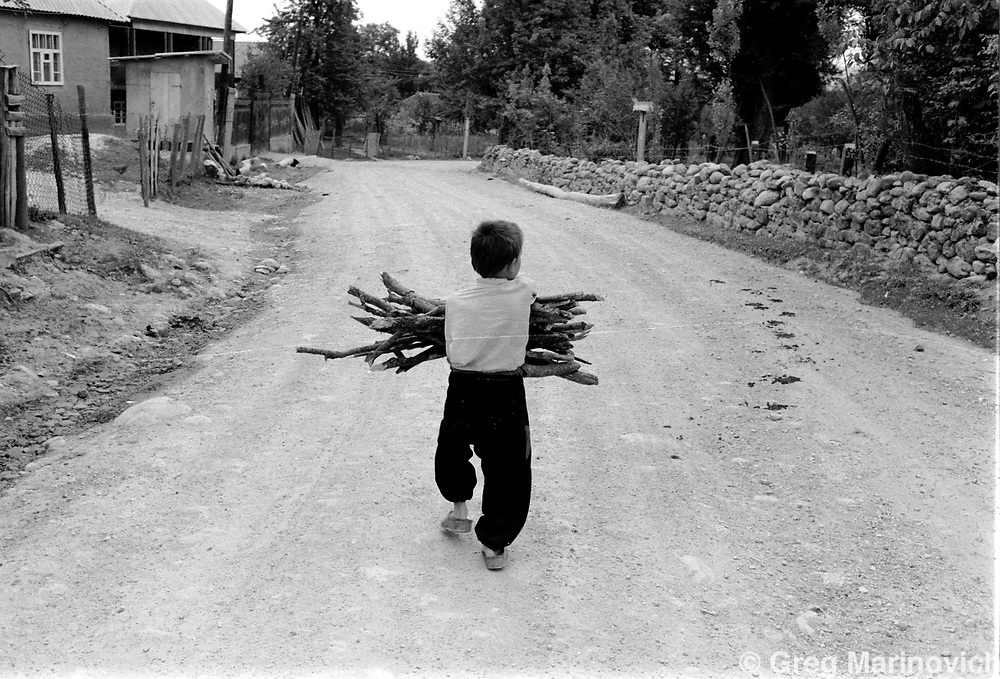 Boy carries firewood, Chechnya. 1995. Greg Marinovich/Getty Images