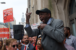 Henry Nicholas, President of the Union of Hospital and Healthcare workers, speaks during a rally hospital workers outside Hahnemann University Hospital at a rally outside the Center City facilities in Philadelphia, PA on July 11, 2019. The struggling Center City located hospital announced it will seize operations and is facing out critical services like Emergency access and the maternity ward unless support is found to end the financial turmoil.