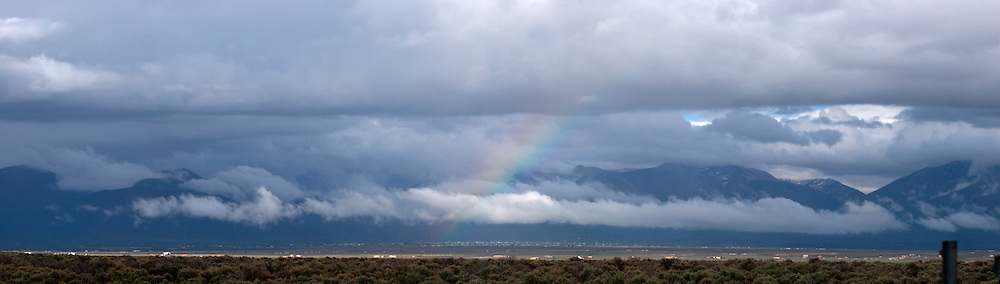 Panoramic Photo of Rainbow over Sangre de Cristo Mountains near Taos, New Mexico
