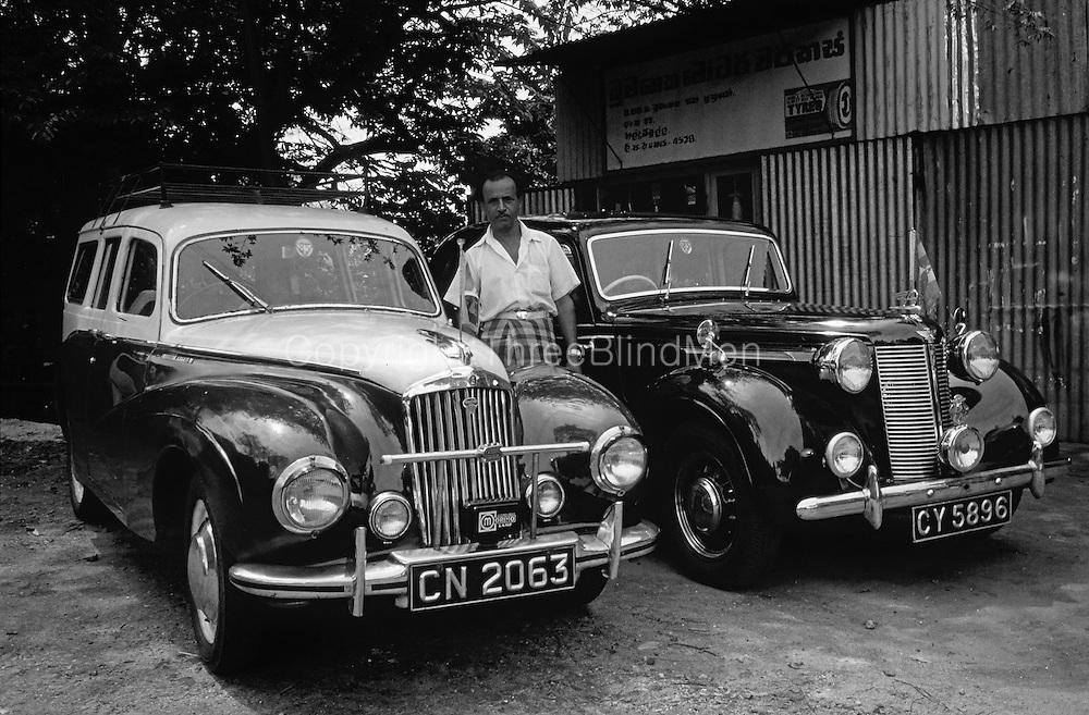 Two fine cars at Haldamulla Garage.