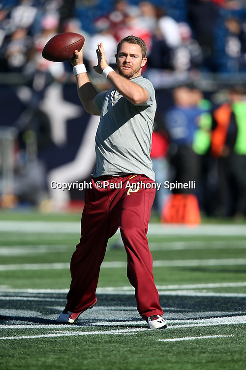 Washington Redskins quarterback Colt McCoy (16) throws a pregame pass while warming up before the 2015 week 9 regular season NFL football game against the New England Patriots on Sunday, Nov. 8, 2015 in Foxborough, Mass. The Patriots won the game 27-10. (©Paul Anthony Spinelli)