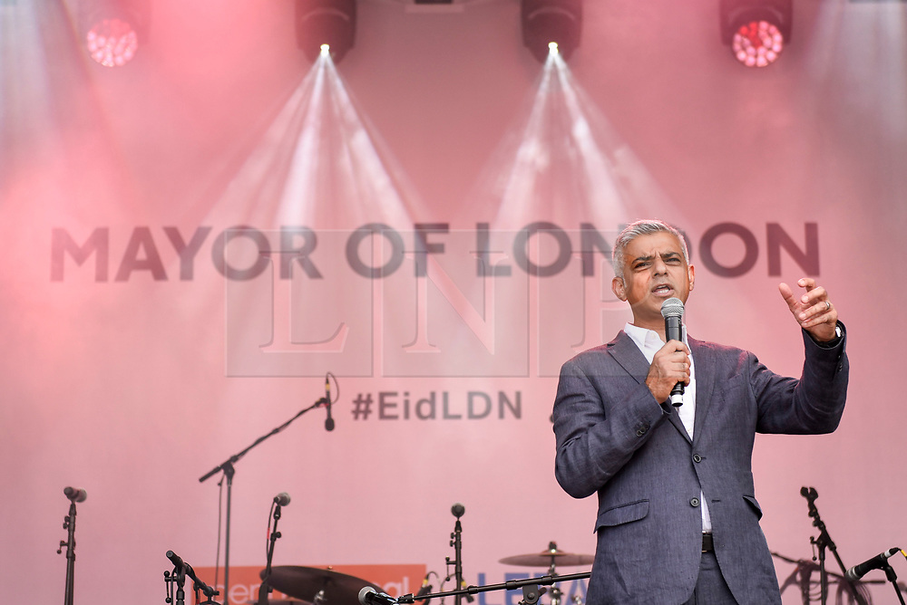 © Licensed to London News Pictures. 23/06/2018. LONDON, UK.  Sadiq Khan, Mayor of London, addresses the audience during the EID Festival in Trafalgar Square, an event hosted by The Mayor of London.  The Mayor's festival takes place in the square one week after the end of Ramadan and includes a variety of stage performances and cultural activities.  Photo credit: Stephen Chung/LNP