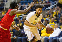Dec 20, 2016; Morgantown, WV, USA; West Virginia Mountaineers forward Esa Ahmad (23) drives towards the basket during the second half against the Radford Highlanders at WVU Coliseum. Mandatory Credit: Ben Queen-USA TODAY Sports