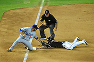 Aug. 6 2011; Phoenix, AZ, USA; Arizona Diamondbacks infielder Ryan Roberts (14) is called safe after advancing to third base on a wild pitch as Los Angeles Dodgers infielder Casey Blake (23) applies a late tag during the ninth inning. The Dodgers defeated the Diamondbacks 5-3 at Chase Field. Mandatory Credit: Jennifer Stewart-US PRESSWIRE.