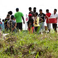 Group of people in the beach of Portobelo. Colon, Panama