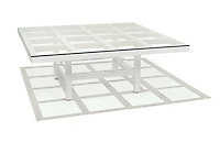 a wood and glass table designed by sol lewitt on a white background.