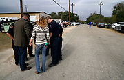 First responders who responded to the shooting at the First Baptist Church of Sutherland Springs, Texas, U.S. pray in the street after a Veteran's Day event in town November 11, 2017.  REUTERS/Rick Wilking