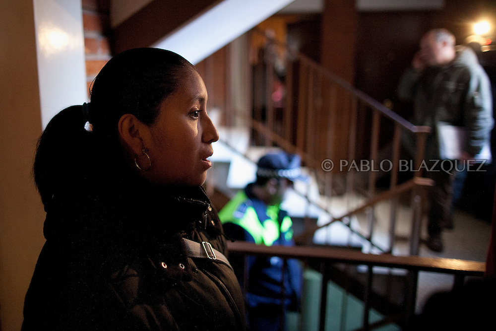 Patricia Tapia, 28, waits before she is given permission to stay in her apartment for another month while a Court Official (R) does a phone call during negotiations on February 15, 2012 in Madrid, Spain. Tapia, an unemployed Ecuadorian mother of two, used to work at a mailing company but when she was six months pregnant the employer decided not to renew her contract and she could not afford to pay her mortgage. The anti-eviction organization 'Platform for People Affected by Mortgages' in Spain has called for a permanent halt to the evictions of families who are struggling to pay their debts because of the poor economic climate.